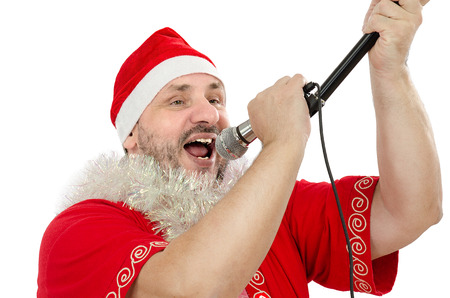 Happy guy in Santa Suit Costume singing in microphone Stock Photo - 24480802