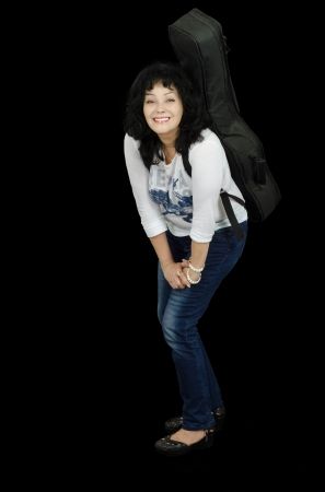 Smiling middle-aged guitarist leaned on her knee Stock Photo - 24731198