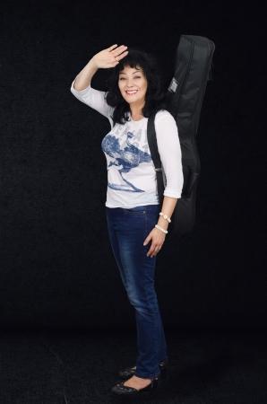 Woman guitarist waving as she went to sound studio Stock Photo - 24731201