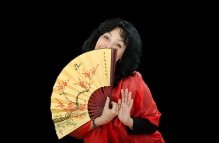 Black-haired woman with japanese fan Stock Photo - 24882314