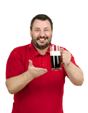 Man in red polo shirt intends to drink a dark beer photo