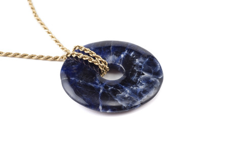 sodalite: Sodalite polished donut with golden chain Stock Photo
