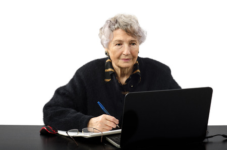 grey haired: Old grey haired woman is elearning student
