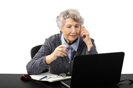grey haired: Modern grey haired teacher having online lesson by skype Stock Photo