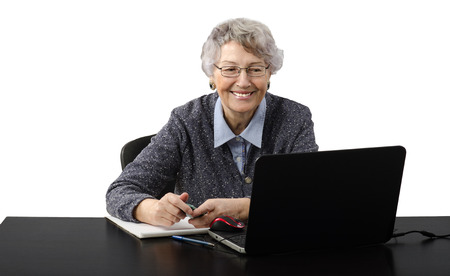 grey haired: Modern grey haired old business lady laughing during skype conversation