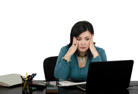 terrified woman: Business lady getting shock watching internet news by leptop