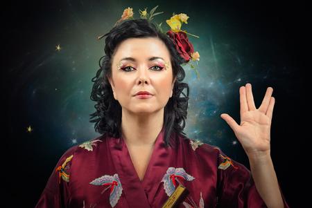 spoke: Flowers haired kimono caucasian woman showing Spoke sign on night sky background