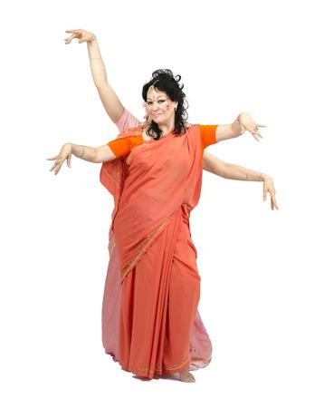 nataraja: Caucasian mature woman in orange sari dancing Nataraja on white background