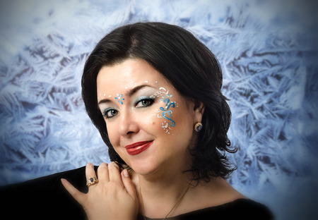 vedic: Face portrait of Caucasian mature woman with Vedic patterns on frost background
