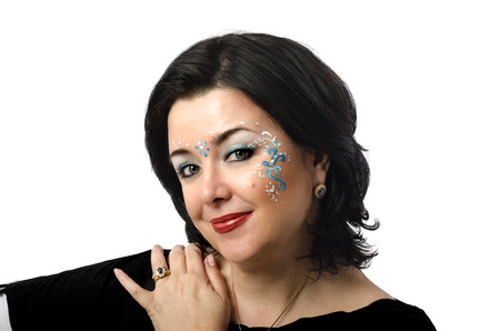 vedic: Beautiful Caucasian mature woman with Vedic style facial makeup on white background