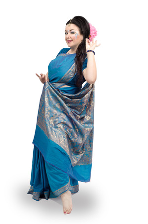 vedic: Full growth portrait of Caucasian mature woman dancing in blue sari on white background