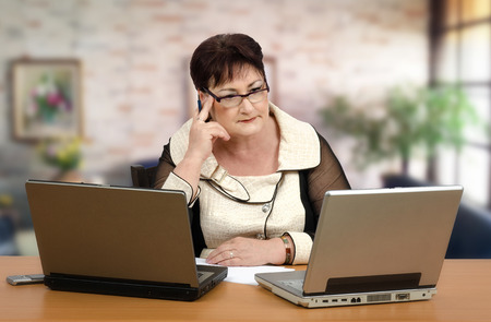 Portrait of middle-aged woman giving individualized online tutoring of math Stock Photo