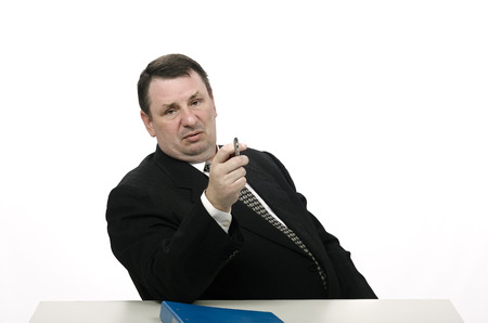 adversarial: Middle-aged arrogant interviewer pointing jobseeker with pen in stress interview