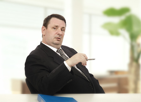 Imposing middle-aged recruiter beginning stress interview for new applicant