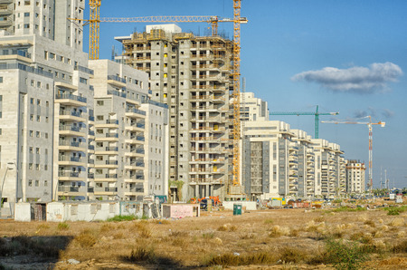 Rishon LeZion, Israel - September 3, 2014: Huge residential apartment buildings under construction in new neighbourhood complex Upper West