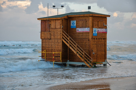 yam israel: Bat Yam, Israel - December 11, 2012:  Unused wooden lifeguard station at the Bat Yam beach in stormy winter morning. Lifeguard stations in Bat-Yam are closed for the wintertime