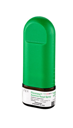 aqueous: Small glass bottle of Flixonase Aqueous Nasal Spray. Treatment of seasonal allergic rhinitis. Manufactured by Glaxo Wellcome SA, Spain