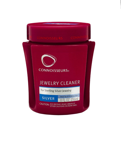 tarnish: Plastic can of Connoisseurs Silver Bath 236 ml. For Sterling Silver Jewellery Cleaning. Produced by Connoisseurs, USA Editorial