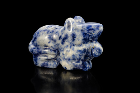 sodalite: Hand carved sodalite figurine rat on black background Stock Photo