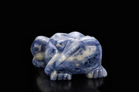 anuran: Sodalite carved frog figurine on black background