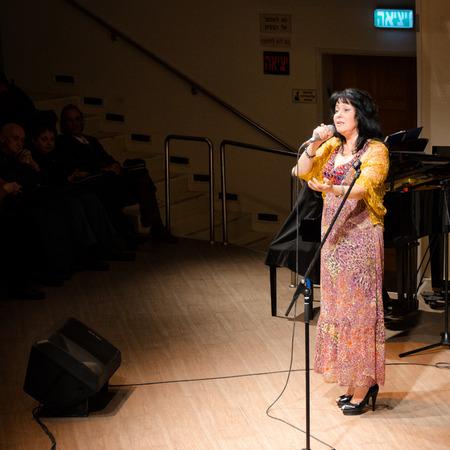 yiddish: Rishon Le Zion, Israel-December 18, 2013: Israeli Yiddish singer Alexandra Gorelik performing on stage at Yiddish Fest in Yad Lebanim hall