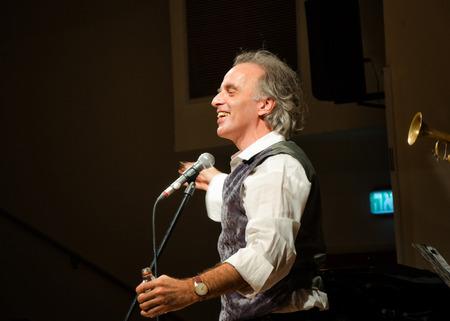 yiddish: Rishon Le Zion, Israel-December 18, 2013: Israeli Yiddish singer Mendy Cahan performs at Yiddish Fest in Yad Lebanim hall Editorial