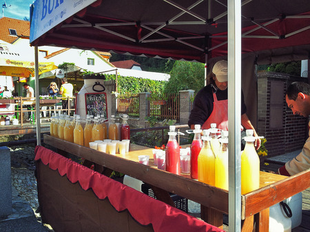 salespeople: Karlstein village, Czech Republic - September 28, 2014: Vendors sell wine Burcak. It is a young Czech partially fermented wine alcohol content is between 5% and 8%. Editorial