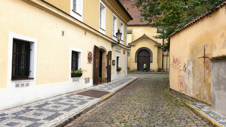 stare mesto: Prague, Czech Republic - September 26, 2014: Small street Anezska in Old Town (Stare Mesto). In the left side is seen the entrance to the restaurant U Cerveneho kola. The building was constructed in 15 century. Editorial