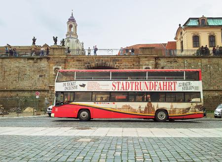 tour bus: Dresden, Germany - September 30, 2014: Open top tour bus Stadtrundfahrt (City Tour) Dresden moving on Terrassenufer street.