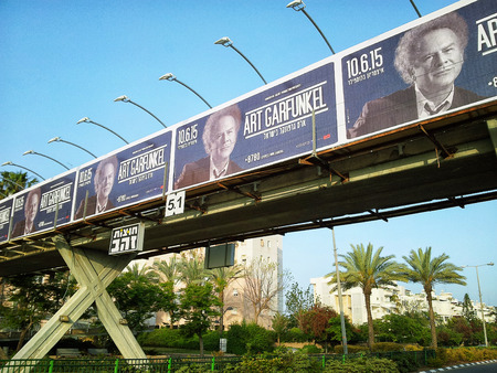 legend: Rishon Le Zion, Israel - April 18, 2015:  Concert billboards of rock and roll legend Art Garfunkel on overhead pedestrian crossing