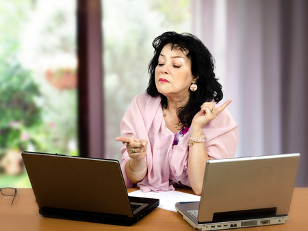 more mature: Mature woman gets testy and says she does not want talking any more online Stock Photo