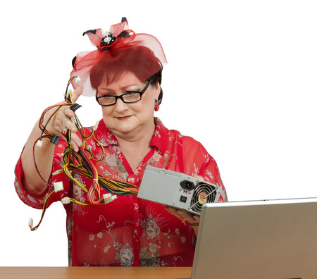 telework: Old woman asks online support to explain how to install the power supply to computer