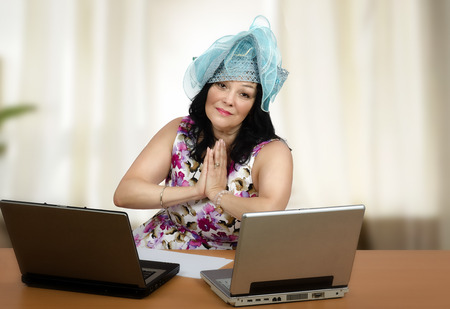 teleworker: New teleworker is worried in front of two laptops before first lesson online Stock Photo