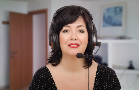 telecommute: Portrait of bilingual teacher working online from home