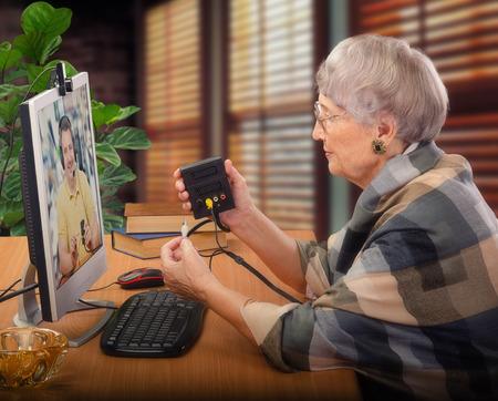 av: Teacher is demonstrating  AV splitter-switcher to senior student by online video chat