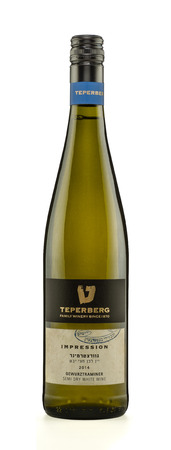Rishon Le Zion, Israel - August 28, 2015: One bottle of semi-dry white wine Teperberg Impression Gewurztraminer 2014 alc.13, 750 ml. Produced in Israel by Teperberg winery 1870 Stock Photo - 47026304