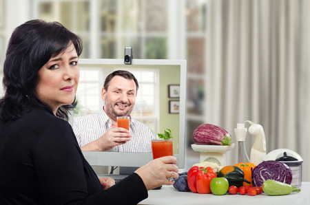 Woman does not want to drink a detox juice has been made under the online supervision of a nutritionist Stock Photo