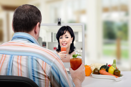 taught man: Dietitian has just taught middle aged man in striped shirt how to make a detox drinks at home during online lesson