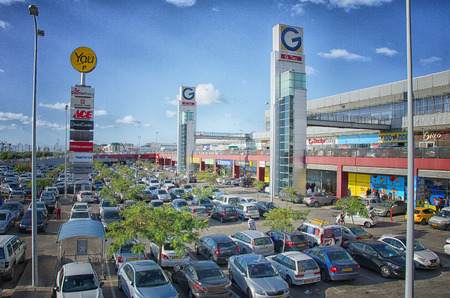 Rishon Le Zion, Israel - January 9, 2016: Open air car park outside G Two huge commercial complex