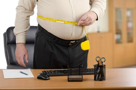 circumference: Man calculates body fat circumference