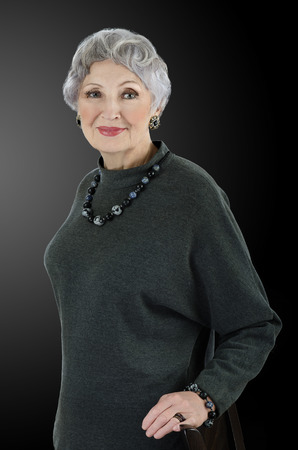 sodalite: Portrait of stunning 76-year-old woman wears snowflakes obsidian sodalite beads necklace with bracelet.