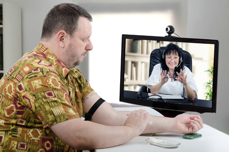 Mature man in Hawaiian shirt wants to give intravenous self injection under telehealth doctor instructions