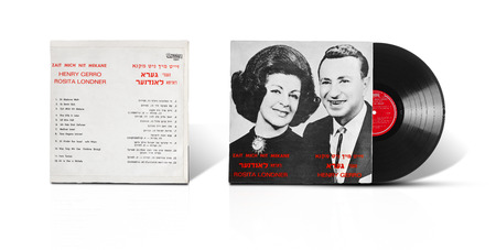 Rishon LeZion, Israel-August 31, 2016:  Old vinyl mono album Zait Mich Nit Mekane. Rosita Londner and Henry Gerro. Compilation of 12 songs in Yiddish. Israeli label Makolit. Covers and vinyl disc are shooted on white background