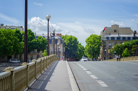 Paris, France - June 4, 2017: Boulevard de la Tour-Maubourg is shot from Invalides bridge. In the left there is sidewalk leading to AMF building. Embassy building of the UAE is located in right side