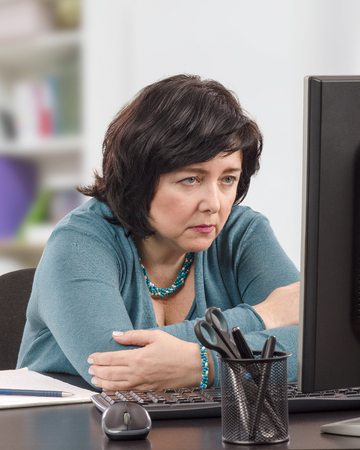 Businesswoman reads fake news on internet but doesnt trust it Stock Photo