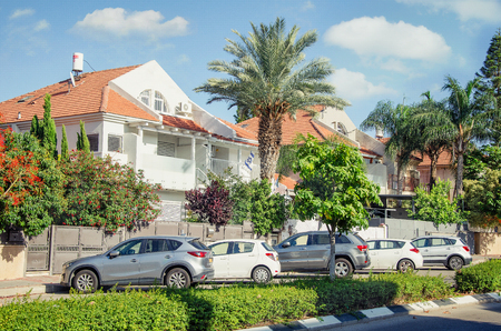 Rishon LeZion, Israel-June 10, 2017: Two white duplex houses with a red tiled roof. Editorial