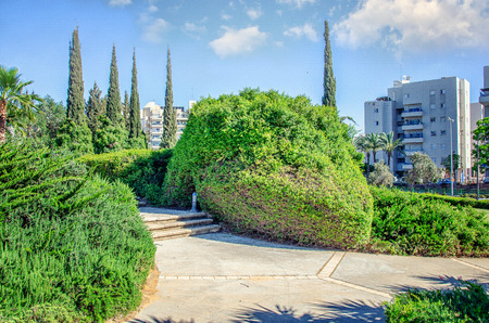 The memorial park of victims of Holocaust in the Carmel neighborhood in Rishon LeTsiyon, Israel. The concrete alleys run through carefully trimmed bushes Archivio Fotografico
