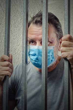 Portrait of a mature adult man arrested for COVID-19 quarantine violation