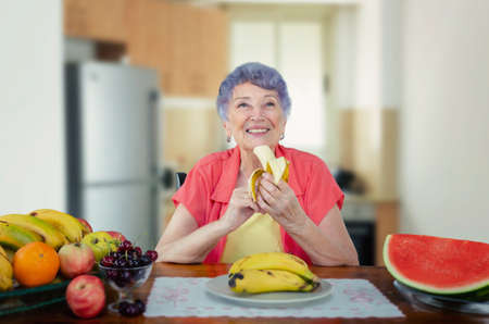 This lonely senior adult woman knows bananas are good for the elderly because they may relieve symptoms of anxiety and depression.