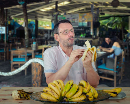 The man ordered a large serving of fresh bananas from a tropical restaurant. He read a lot about their usefulness.